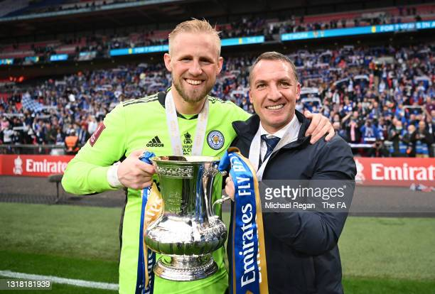 Kasper Schmeichel of Leicester City and Brendan Rodgers, Manager of Leicester City celebrate with the Emirates FA Cup trophy following The Emirates...