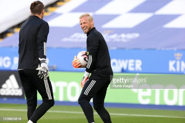 Kasper Schmeichel of Leicester City and Eldin Jakupovic of Leicester City warm up ahead of the Premier League match between Leicester City and...