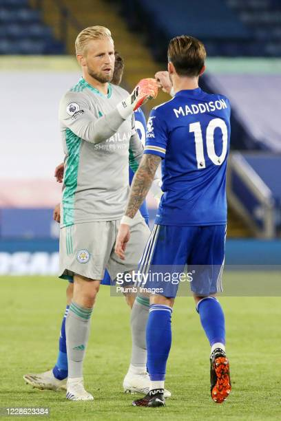 Kasper Schmeichel of Leicester City and James Maddison of Leicester City celebrate after the Premier League match between Leicester City and Burnley...