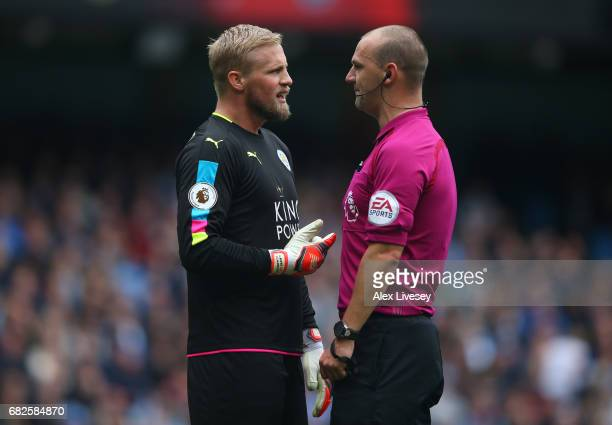 Kasper Schmeichel of Leicester City and referee Bobby Madley speak during the Premier League match between Manchester City and Leicester City at...