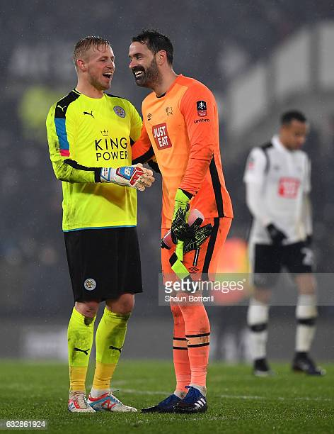 Kasper Schmeichel of Leicester City and Scott Carson of Derby County speak during The Emirates FA Cup Fourth Round match between Derby County and...
