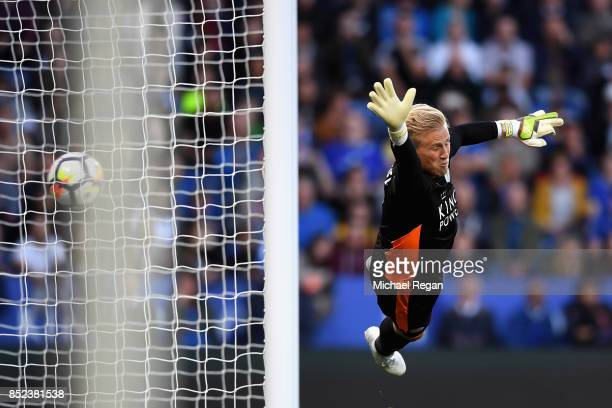Kasper Schmeichel of Leicester City attempts to save as Philippe Coutinho of Liverpool scores his sides second goal during the Premier League match...