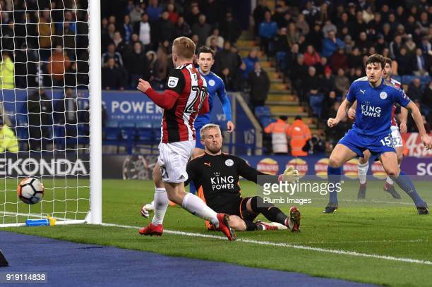 Kasper Schmeichel of Leicester City blocks an effort from Mark Duffy of Sheffield United during the FA Cup Fifth round match between Leicester City...