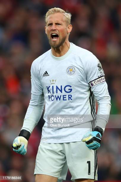 Kasper Schmeichel of Leicester City celebrates after his team score their first goal during the Premier League match between Liverpool FC and...
