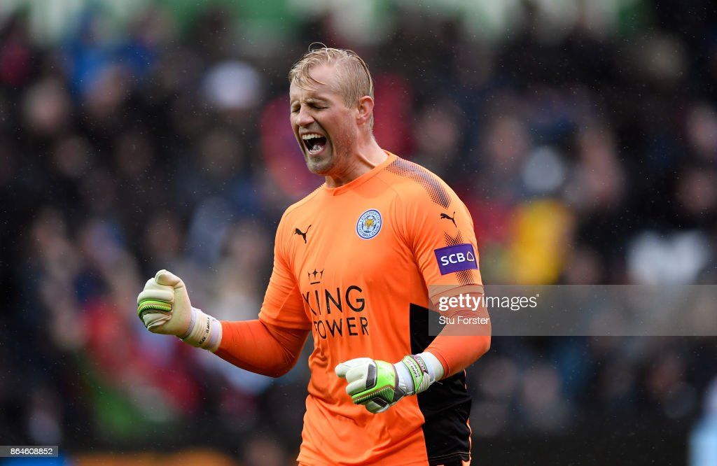 Kasper Schmeichel of Leicester City celebrates after Leicester City scored there first goal during the Premier League match between Swansea City and Leicester City at Liberty Stadium on October 21, 2017 in Swansea, Wales.