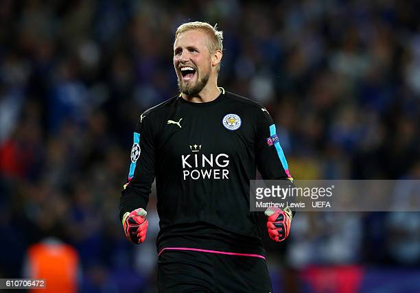 Kasper Schmeichel of Leicester City celebrates as Islam Slimani of Leicester City scores their first goal during the UEFA Champions League Group G...