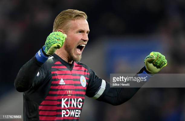 Kasper Schmeichel of Leicester City celebrates as Jamie Vardy of Leicester City scores his team's second goal during the Premier League match between...