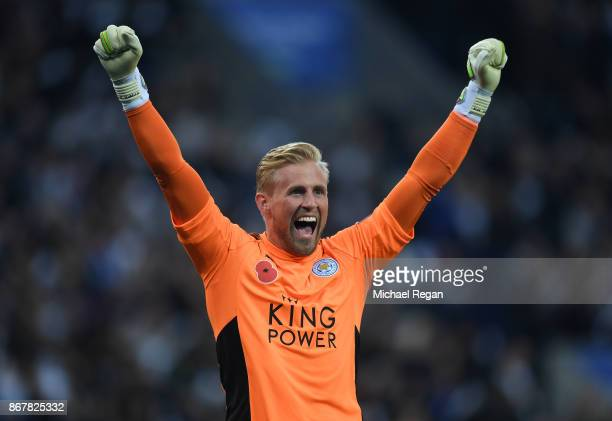 Kasper Schmeichel of Leicester City celebrates as Jamie Vardy of Leicester City scores their first goal during the Premier League match between...