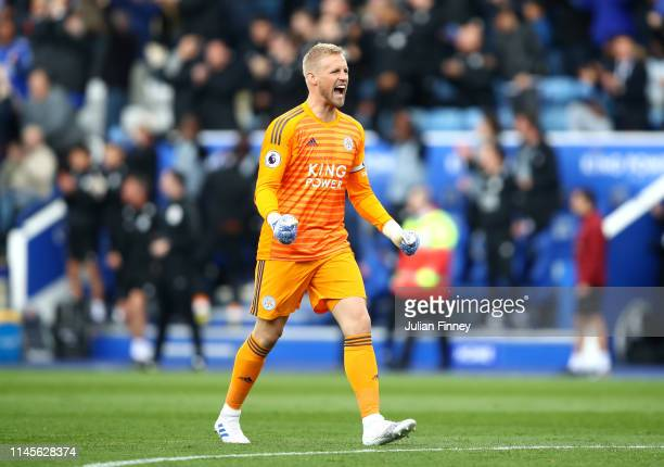 Kasper Schmeichel of Leicester City celebrates his sides first goal scored by Youri Tielemans during the Premier League match between Leicester City...