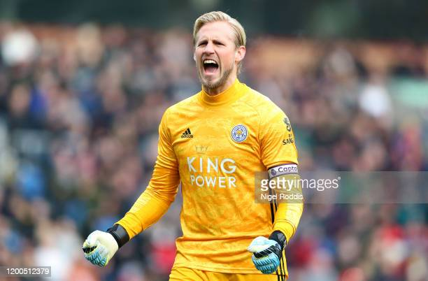 Kasper Schmeichel of Leicester City celebrates his sides first goal during the Premier League match between Burnley FC and Leicester City at Turf...