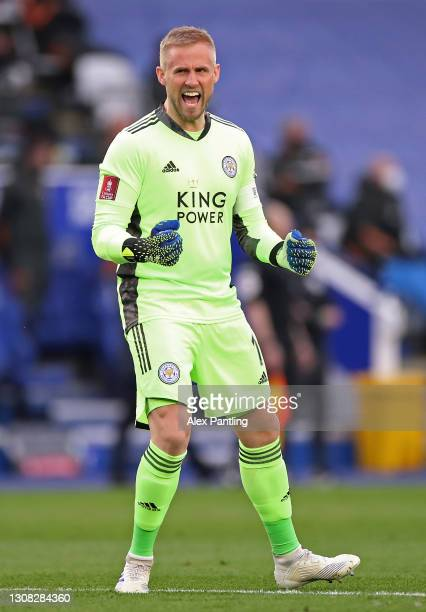 Kasper Schmeichel of Leicester City celebrates his side's first goal scored by Kelechi Iheanacho of Leicester City during the Emirates FA Cup Quarter...