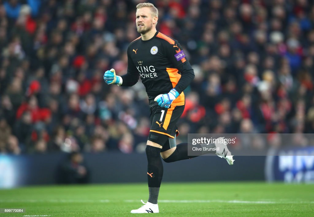 Kasper Schmeichel of Leicester City celebrates his sides first goal during the Premier League match between Liverpool and Leicester City at Anfield on December 30, 2017 in Liverpool, England.