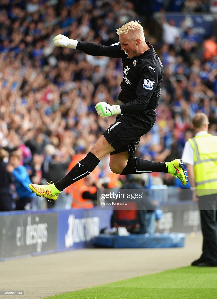 Kasper Schmeichel of Leicester City celebrates the goal scored by Chris Wood of Leicester City during the Barclays Premier League match between Leicester City and Everton at the King Power Stadium on August 16, 2014 in Leicester, England.