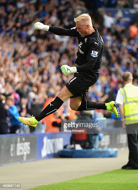 Kasper Schmeichel of Leicester City celebrates the goal scored by Chris Wood of Leicester City during the Barclays Premier League match between...