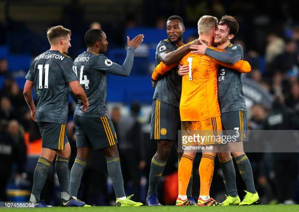 Kasper Schmeichel of Leicester City celebrates victory with Ben Chilwell of Leicester City and Wes Morgan of Leicestr City during the Premier League...