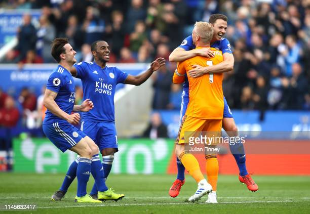 Kasper Schmeichel of Leicester City celebrates with Jonny Evans and team mates as he assists with a goal for Jamie Vardy during the Premier League...