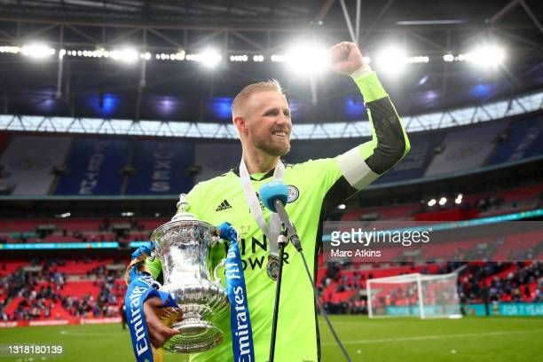 Kasper Schmeichel of Leicester City celebrates with the Emirates FA Cup trophy following his team's victory in The Emirates FA Cup Final match...