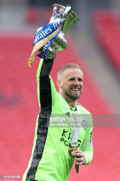 Kasper Schmeichel of Leicester City celebrates with the Emirates FA Cup trophy following The Emirates FA Cup Final match between Chelsea and...