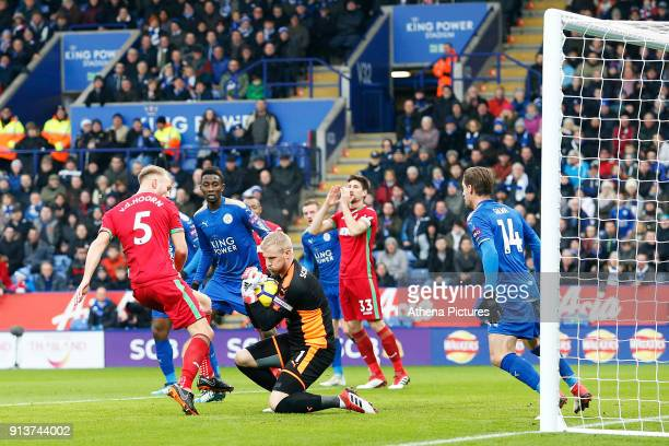 Kasper Schmeichel of Leicester City collects the ball under pressure from Mike van der Hoorn of Swansea during a corner in the Premier League match...