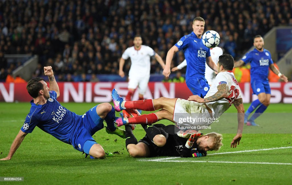 Kasper Schmeichel of Leicester City concedes a penalty as he brings down Vitolo of Sevilla during the UEFA Champions League Round of 16, second leg match between Leicester City and Sevilla FC at The King Power Stadium on March 14, 2017 in Leicester, United Kingdom.