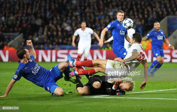 Kasper Schmeichel of Leicester City concedes a penalty as he brings down Vitolo of Sevilla during the UEFA Champions League Round of 16 second leg...