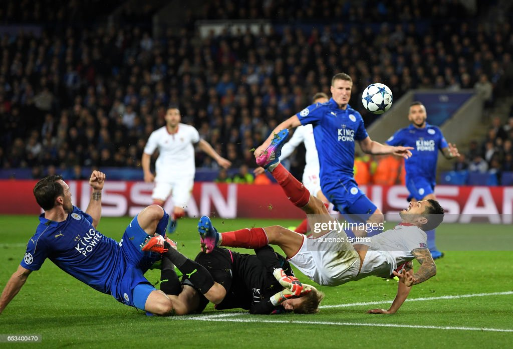 Kasper Schmeichel of Leicester City concedes a penalty as he brings down Vitolo of Sevilla during the UEFA Champions League Round of 16 second leg match between Leicester City and Sevilla FC at The King Power Stadium on March 14, 2017 in Leicester, United Kingdom.
