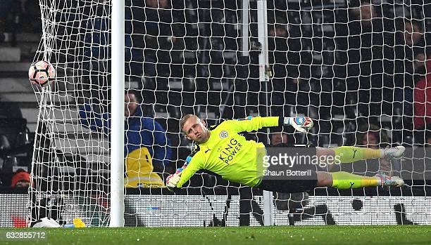 Kasper Schmeichel of Leicester City dives as Darren Bent of Derby County scores his sides first goal during The Emirates FA Cup Fourth Round match...