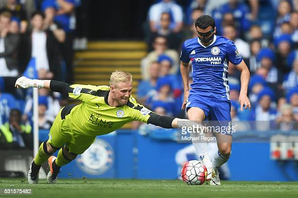 Kasper Schmeichel of Leicester City dives for the ball with Pedro Rodriguez of Chelsea during the Barclays Premier League match between Chelsea and...