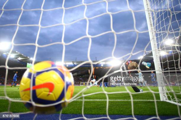 Kasper Schmeichel of Leicester City dives in vain as Kevin De Bruyne of Manchester City scores his side's second goal during the Premier League match...