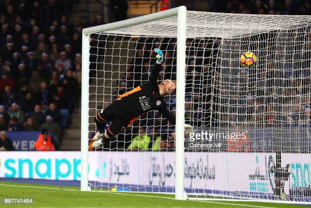 Kasper Schmeichel of Leicester City fails to stop a free kick from Juan Mata of Manchester United during the Premier League match between Leicester...
