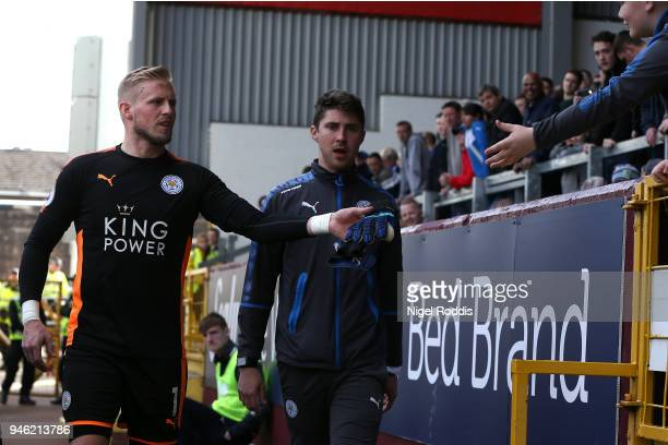 Kasper Schmeichel of Leicester City gives a fan his gloves after the Premier League match between Burnley and Leicester City at Turf Moor on April 14...