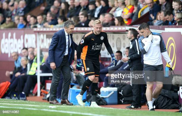 Kasper Schmeichel of Leicester City goes off injured during the Premier League match between Burnley and Leicester City at Turf Moor on April 14th...