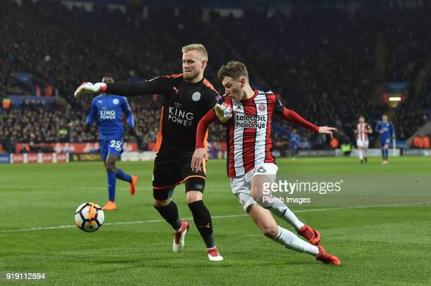 Kasper Schmeichel of Leicester City holds off Chris Basham of Sheffield United during the FA Cup Fifth round match between Leicester City and...
