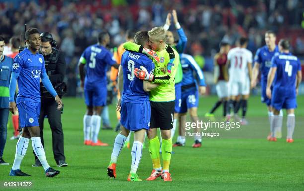 Kasper Schmeichel of Leicester City hugs Jamie Vardy of Leicester City after the UEFA Champions League Round of 16 First Leg between Sevilla FC and...