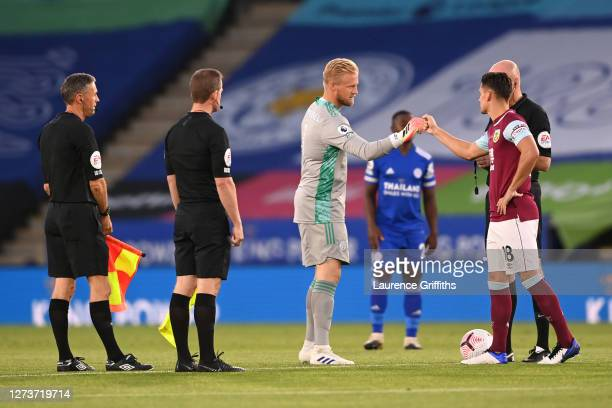 Kasper Schmeichel of Leicester City interacts with Ashley Westwood of Burnley prior to the Premier League match between Leicester City and Burnley at...