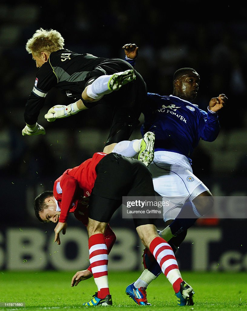 Kasper Schmeichel of Leicester City is taken out by Greg Cunningham of Nottingham Forest during the npower championship match between Leicester City and Nottingham Forest at The King Power Stadium on March 27, 2012 in Leicester, England.