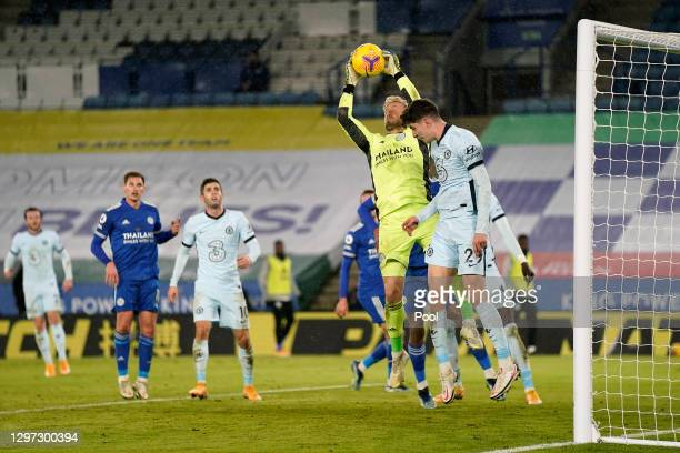 Kasper Schmeichel of Leicester City jumps to collect the ball above Kai Havertz of Chelsea during the Premier League match between Leicester City and...