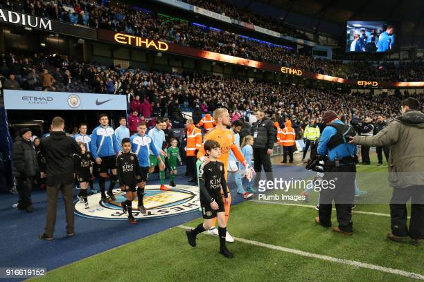 Kasper Schmeichel of Leicester City leads his team out at Etihad Stadium ahead of the Premier League match between Manchester City and Leicester City...