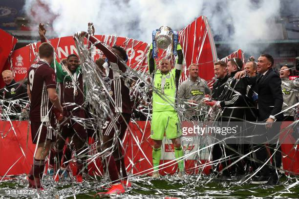 Kasper Schmeichel of Leicester City lifts the Emirates FA Cup Trophy in celebration with team mates following The Emirates FA Cup Final match between...