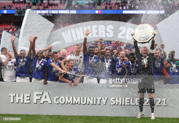 Kasper Schmeichel of Leicester City lifts The FA Community Shield as his team mates celebrate following victory in The FA Community Shield Final...