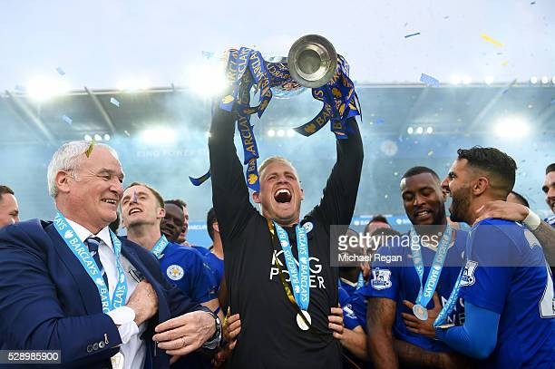Kasper Schmeichel of Leicester City lifts the Premier League Trophy as players and staffs celebrate the season champion after the Barclays Premier...