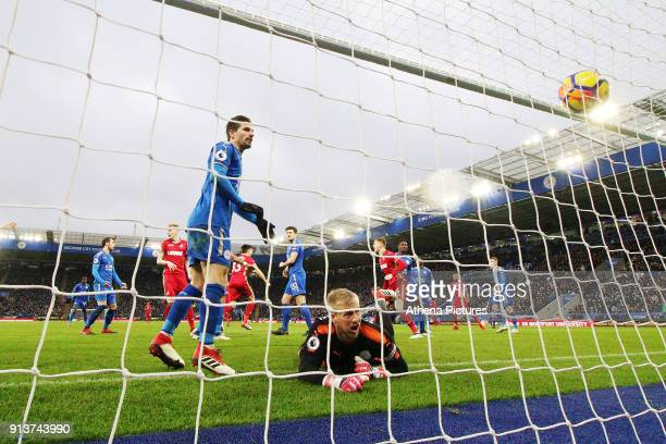 Kasper Schmeichel of Leicester City looks dejected as Federico Fernandez of Swansea scores his sides first goal of the match to equalise during the...