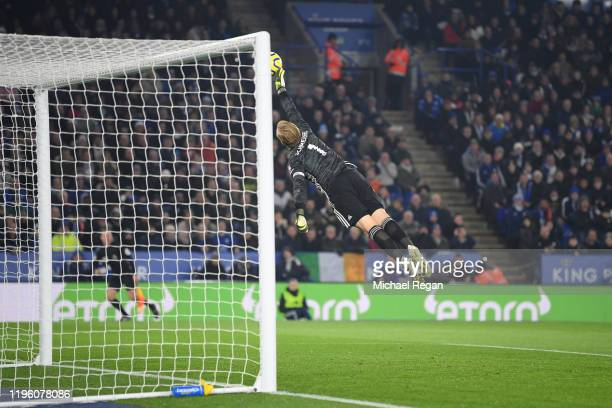 Kasper Schmeichel of Leicester City makes a save during the Premier League match between Leicester City and Liverpool FC at The King Power Stadium on...