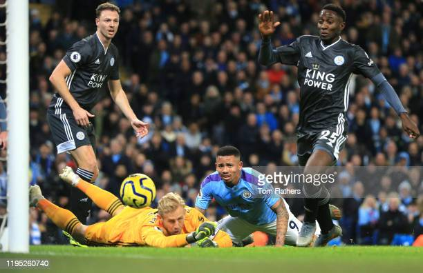 Kasper Schmeichel of Leicester City makes a save from Gabriel Jesus of Manchester City during the Premier League match between Manchester City and...