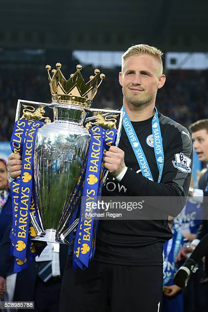 Kasper Schmeichel of Leicester City poses with the Premier League Trophy as players and staffs celebrate the season champions after the Barclays...