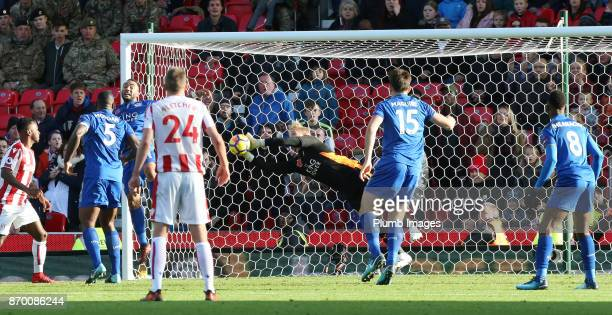 Kasper Schmeichel of Leicester City pulls off a crucial save in the dying minutes during the Premier League match between Stoke City and Leicester...