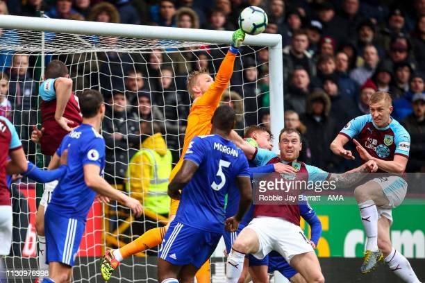Kasper Schmeichel of Leicester City punches the ball clear during the Premier League match between Burnley FC and Leicester City at Turf Moor on...