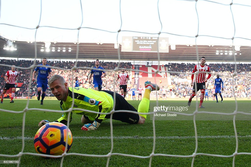 Kasper Schmeichel of Leicester City reacts as Dusan Tadic of Southampton (R) converts the penalty to score his team's third goal during the Premier League match between Southampton and Leicester City at St Mary's Stadium on January 22, 2017 in Southampton, England.