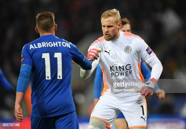 Kasper Schmeichel of Leicester City reacts with team mate Marc Albrighton during The Emirates FA Cup Quarter Final match between Leicester City and...