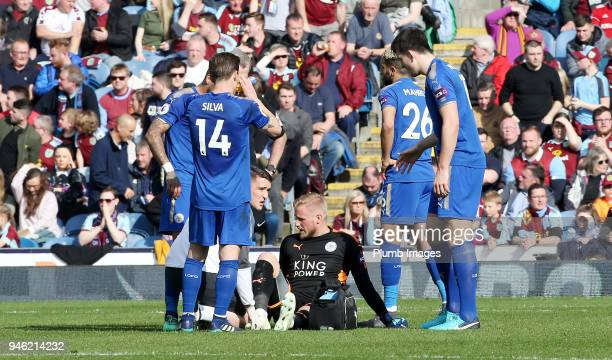 Kasper Schmeichel of Leicester City receives treatment before having to be substituted during the Premier League match between Burnley and Leicester...